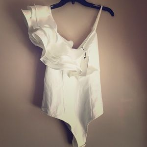 Alpha & Omega ruffled white bodysuit
